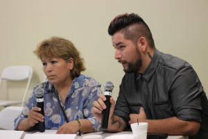 Alessandro Nagrete sitting next to his mother, Irma Montoya; translating from Spanish  language into English language for the audience  to understand his mother's experience as  a sick woman and undocumented.