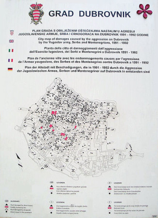 Map in Dubrovnik that shows the extent of war damage in the Old Town. The triangles represent direct impacts while the red shadings represent fires. Joy [Public domain], via Wikimedia Commons